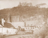 This is a view from behind the citadel. Before the expansion of the town. Nowadays the buildings still stand but I believe there's a hotel newly built standing where the actual camera stood when this photo was taken.